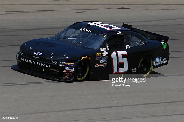 Todd Peck driver of the Lilly Trucking/Carport Empire Ford drives during practice for the NASCAR XFINITY Series Menards 250 at Michigan International...