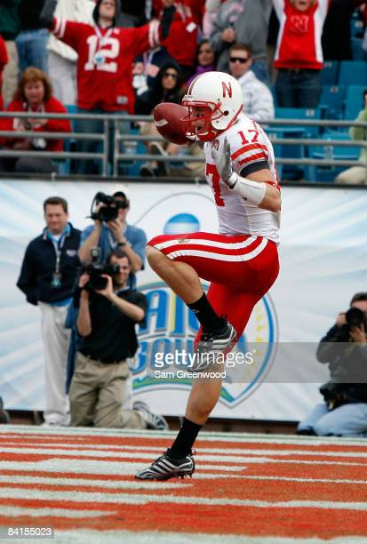 Todd Peterson of the Nebraska Cornhuskers celebrates a touchdown reception during the Konica Minolta Gator Bowl against the Clemson Tigers at...