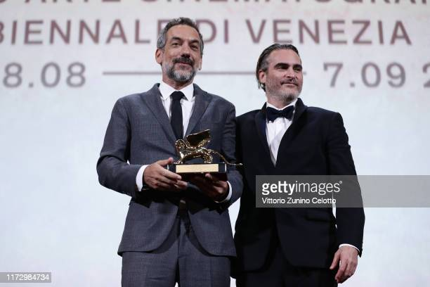 Todd Phillips and Joaquin Phoenix receive the Golden Lion for Best Film Award for 'Joker' during the Award Ceremony during the 76th Venice Film...