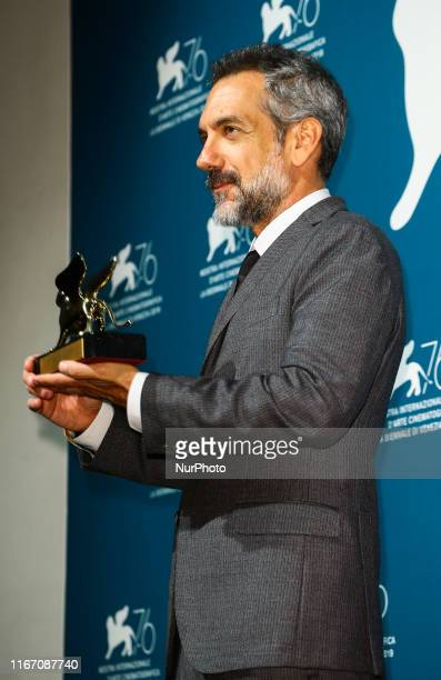 Todd Phillips poses with the Golden Lion for Best Film Award for Joker at the Winners Photocall during the 76th Venice Film Festival at Sala Grande...