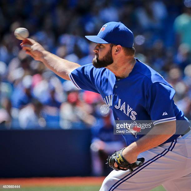 Todd Redmond of the Toronto Blue Jays pitched the 8th inning for the Jays.Toronto Blue Jays defeated the Boston Red Sox 8-0 at the Rogers Centre July...
