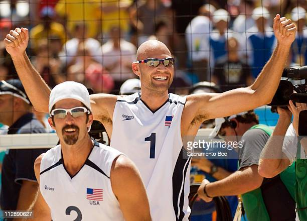 Todd Rogers left and Philip Dalhausser of the United States celebrate a point on the way to winning gold in beach volleyball on Friday August 22 in...