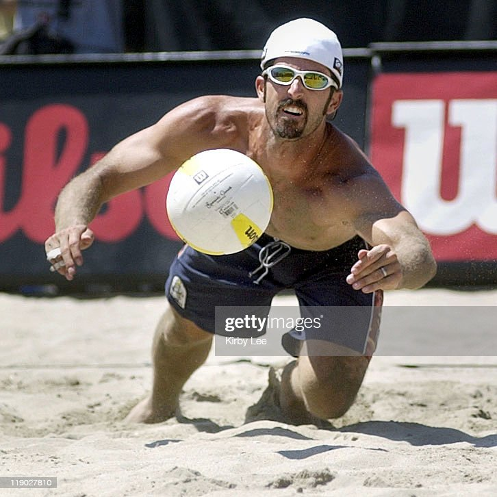 Todd Rogers makes an unsuccesful dig attempt in the final of the AVP Huntington Beach Open professional men's beach volleyball tournament. Rogers and Sean Scott lost to Karch Kiraly and Brent Doble, 21-16, 21-16, in Huntington Beach, Calif. on Sunday, Aug. 17, 2003. Kiraly won his record 144th tournament and broke his own record for oldest player to win an AVP tournament at age 42.