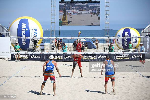 Todd Rogers serves the ball into play to Stafford Slick and Casey Jennings all of USA during the men's elimination round at the ASICS World Series of...