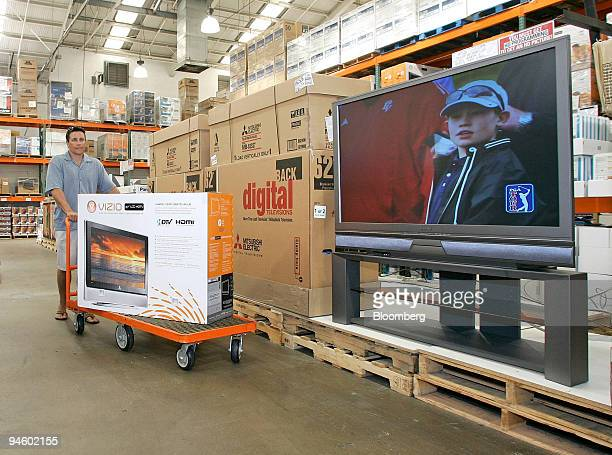 Todd Sabo pushes a 37 LCD television past a display of 62 TV's inside a Costco in San Diego California Wednesday June 21 2006