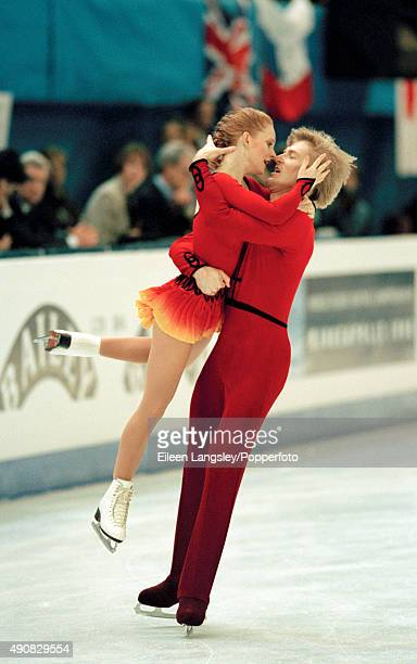 Todd Sand and Jenni Meno of the United States in action in the pairs figure skating event during the Winter Olympic Games in Lillehammer Norway circa...