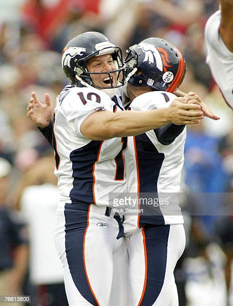 Todd Sauerbrun and Jason Elam of the Denver Broncos celebrate Elam's 42 yard game winning field goal with 0:00 time left against the Buffalo Bills at...