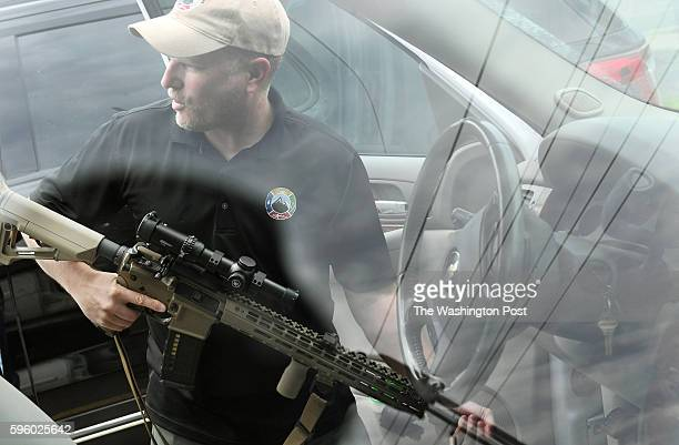 Todd Savage of Survival Retreat Consulting and American Redoubt Realty displays a firearm that he routinely takes with him on Thursday June 23 2016...