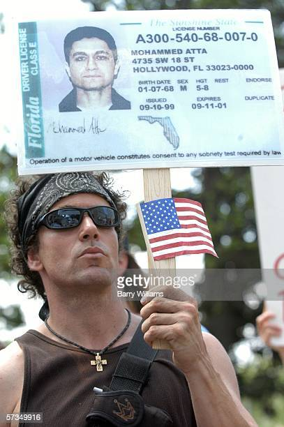 Todd Shaw displays a mockup of a Florida driver's license with the image of 9/11 hijacker Mohammed Atta during a rally on the steps of the state...