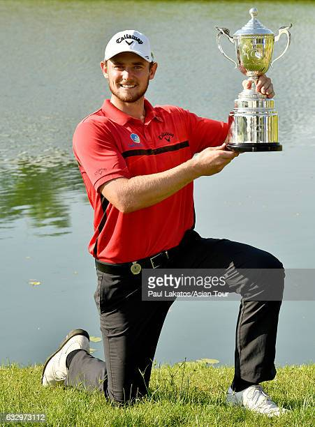 Todd Sinnott of Australia pictured with the winner's trophy after round four of the Leopalace21 Myanmar Open at Pun Hlaing Golf Club on January 29,...