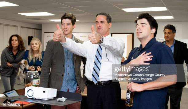 Todd Spitzer center gives the thumbs up at his campaign headquarters in Santa Ana on Tuesday June 5 2018 when election results show he has closed the...