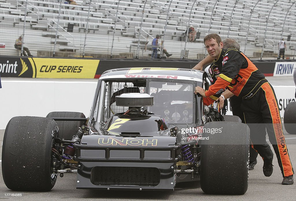 Todd Szegedy, driver of the #2 UNOH/Dunleavy Repair Ford waits on pit road during qualifying for the NASCAR Whelen Tour Titan roof 150 at Bristol Motor Speedway on August 21, 2013 in Bristol, Tennessee.