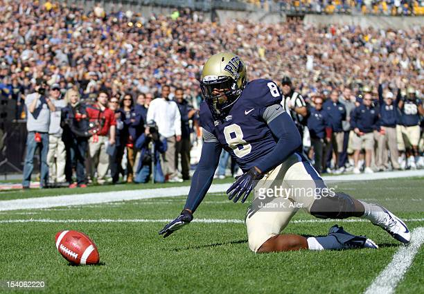 Todd Thomas of the Pittsburgh Panthers falls on a blocked punt in the end zone for a touchdown against the Louisville Cardinals during the game on...
