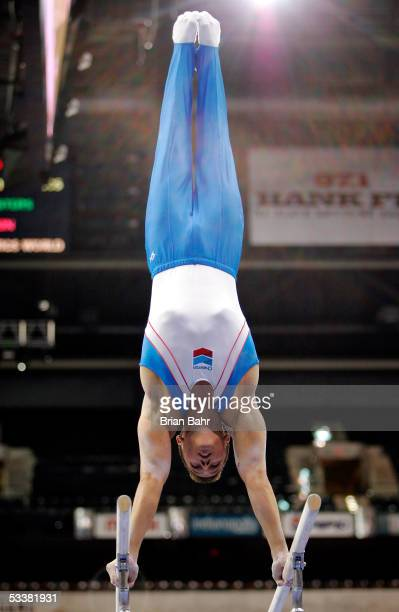 Todd Thornton performs on the parallel bars during the men's finals of the 2005 Visa Championships on August 12, 2005 at the Conseco Fieldhouse in...