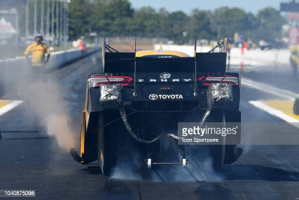 Todd Toyota Camry NHRA Funny Car does a burnout during the NHRA AAA Midwest Nationals on September 23 at Gateway Motorsports Park in Madison Illinois