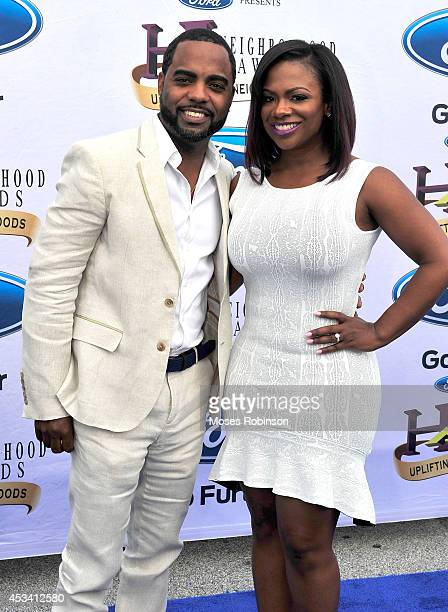 Todd Tucker and TV personality Kandi Burruss attend the 2014 Ford Neighborhood Awards Hosted By Steve Harvey at the Phillips Arena on August 9 2014...