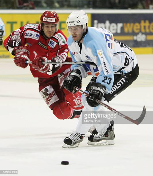 Todd Warriner of Hanover and Paul Manning of Hamburg fights for the puck during the Bundesliga game between Hanover Scorpions and Hamburg Freezers at...