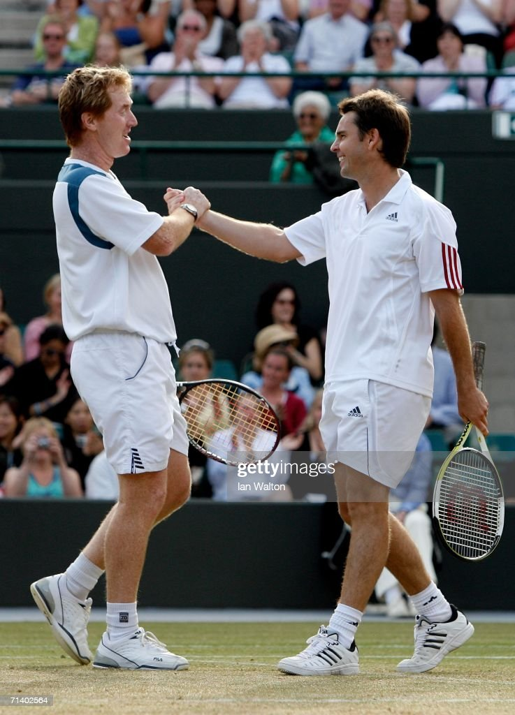 Todd Woodbridge (R) and Mark Woodforde (L) of Australia celebrate after winning the Gentlemen's 35 & over doubles against T-J Middleton and David Wheaton of the United States on day thirteen of the Wimbledon Lawn Tennis Championships at the All England Lawn Tennis and Croquet Club on July 9, 2006 in London, England.