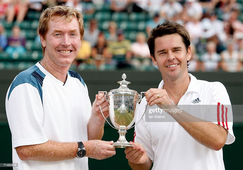 Todd Woodbridge (R) and Mark Woodforde (L) of Australia hold the trophy after winning the Gentlemen's 35 & over doubles against T-J Middleton and David Wheaton of the United States on day thirteen of the Wimbledon Lawn Tennis Championships at the All England Lawn Tennis and Croquet Club on July 9, 2006 in London, England.