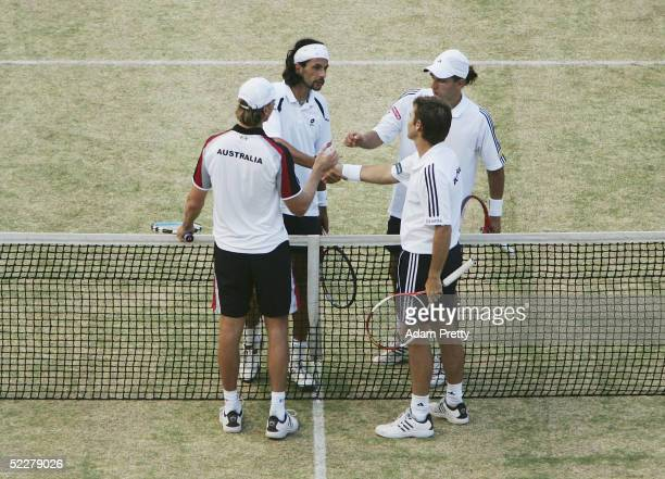 Todd Woodbridge and Wayne Arthurs of Australia are congratulated by Jurgen Melzer and Julian Knowle of Austria during the third rubber of the Davis...