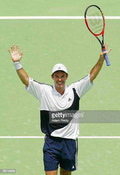 Todd Woodbridge of Australia and Jonas Bjorkman of Sweden celebrate victory in the mens doubles final as Todd Woodbridge becomes the most successful...