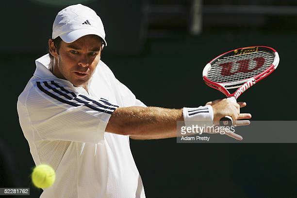 Todd Woodbridge of Australia in action against Marco Mirnegg of Austria during fourth rubber of the Davis Cup Tie between Australia and Austria on...
