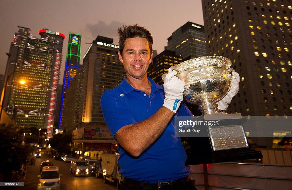 Todd Woodbridge poses for the press, with the AO men's trophy in Hong Kong, during the Australian Open Trophy tour on October 22, 2013 in Hong Kong, Hong Kong.