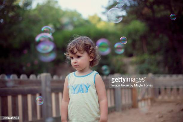 toddler and bubbles at the park
