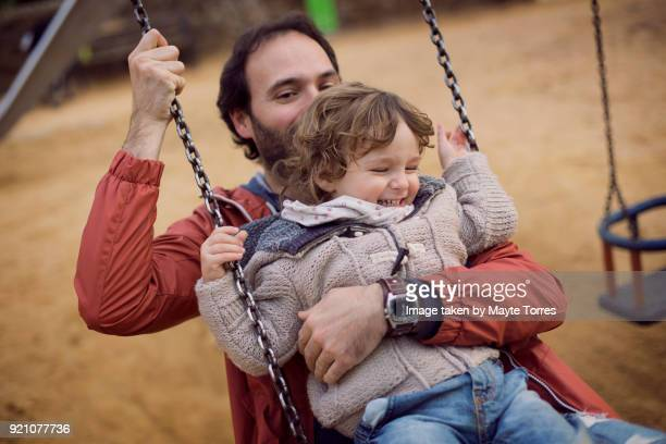 Toddler and dad in the swing