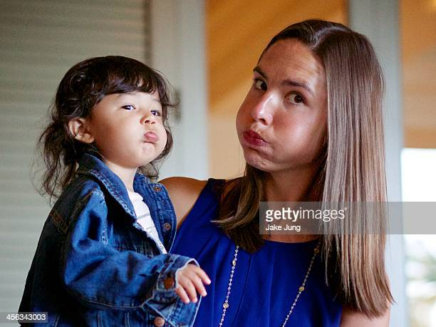 toddler and her aunt puffing out their cheeks - aunt fotografías e imágenes de stock