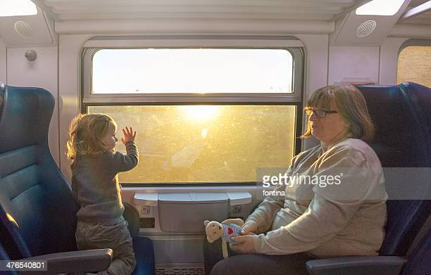 toddler and her  grandmother travelling by train