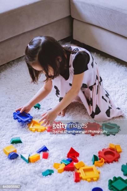 Toddler arranging toy blocks