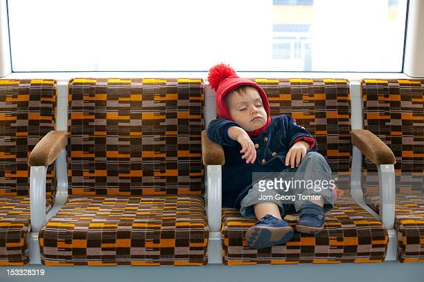 Toddler asleep on public transport