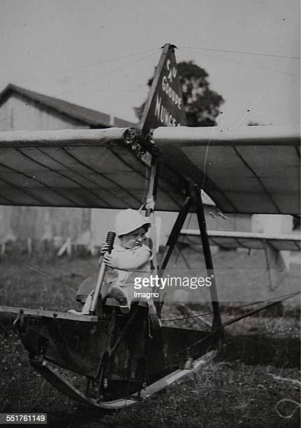 Toddler at his first attempt on a glider About 1930 Photograph