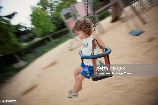 Toddler at the swing going fast