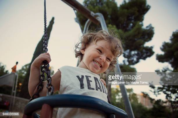 toddler at the swing laughing - candid stock pictures, royalty-free photos & images