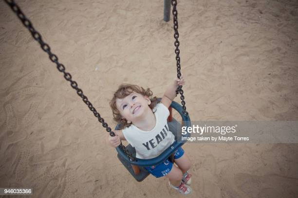Toddler at the swing looking up