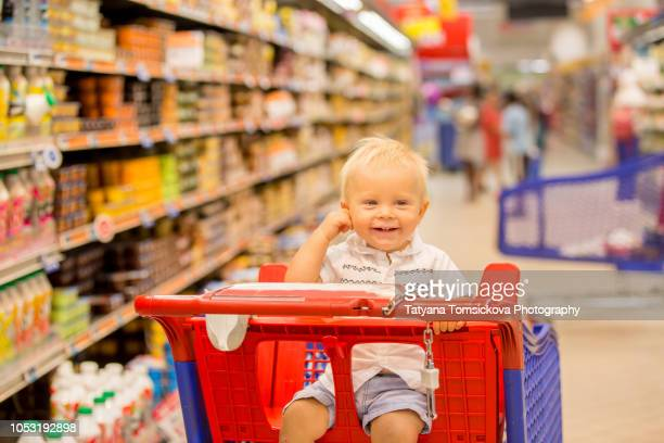 917610ece Baby In Shopping Cart Stock Photos and Pictures