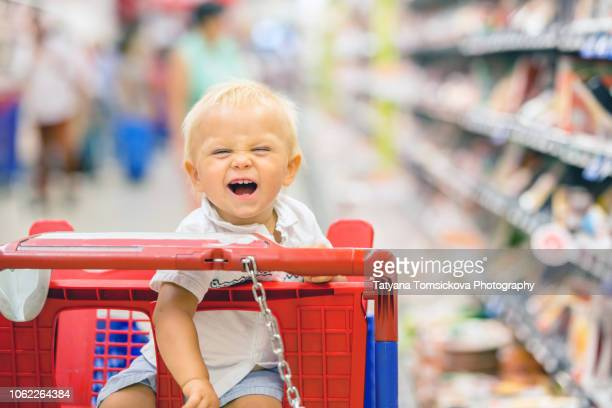 f99a38878 Full Shopping Cart In Grocery Store Stock Photos and Pictures