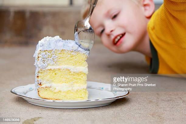 Toddler boy and large slice of cake