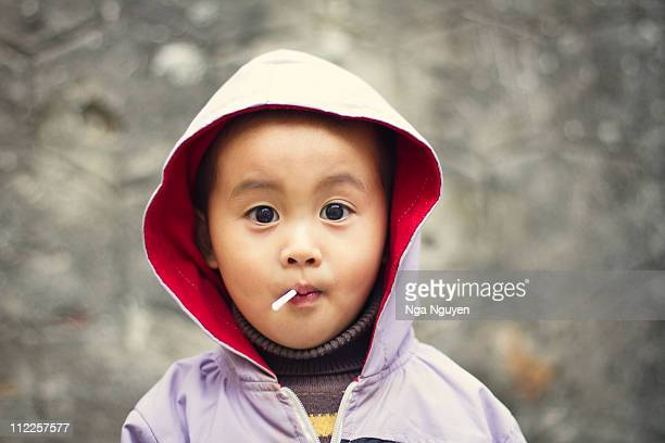 Toddler boy eating lollipop