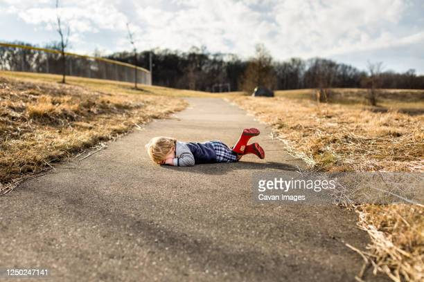 toddler boy having a tantrum on walking path - red boot stock pictures, royalty-free photos & images