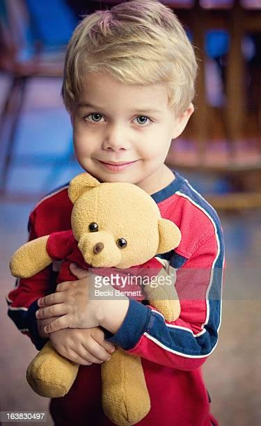 Toddler boy hugging teddybear