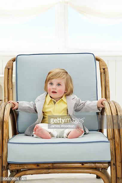 Toddler boy (12-15 months) in arm chair, close-up