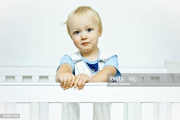 Toddler boy in cot