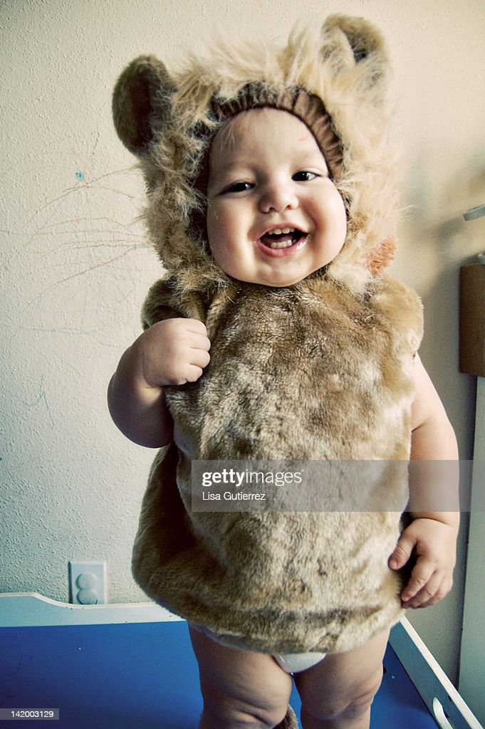 Toddler boy in lion costume : Stock Photo