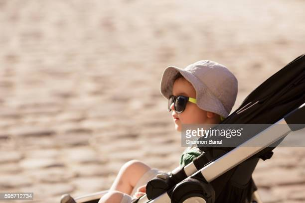 Toddler Boy in Stroller in France on a Summer's Eve