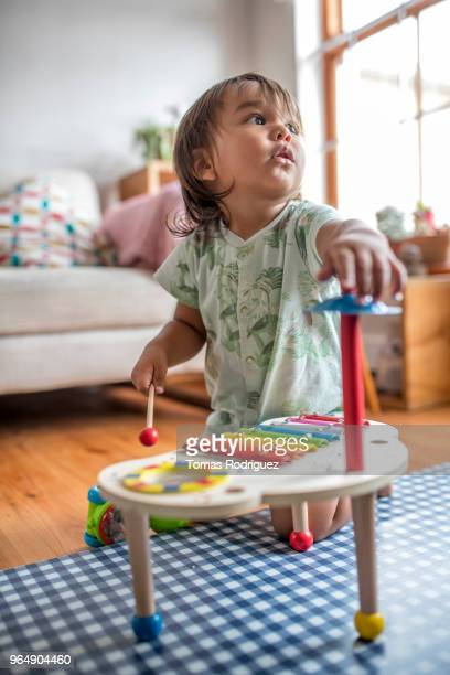 Toddler boy in the living room with a xylophone