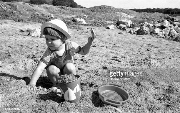 toddler boy of two playing at beach - 1980 bildbanksfoton och bilder