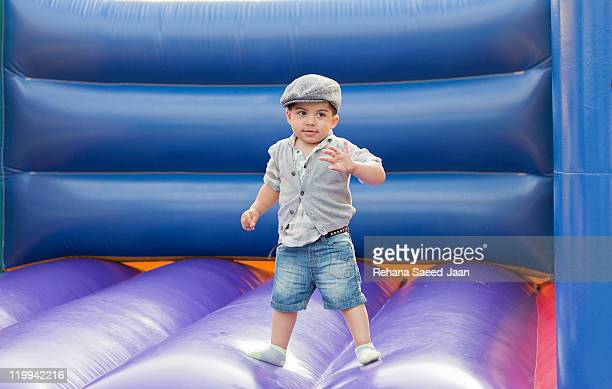 Toddler boy on bouncy castle